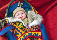 Ethnic baby doll of small peoples living in the north of Siberia in Russia stock image