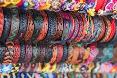 Ethnic background leather bracelets. Multicolored ethnic background leather bracelets royalty free stock photos