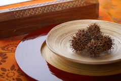 Ethnic bamboo dish. Image of an ethnic bamboo dish with a  box for incense Stock Photography