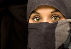 Ethnic beautiful green eyes woman. Isolated in black portrait Royalty Free Stock Photos