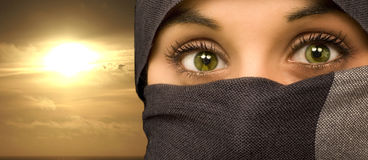 Ethnic beautiful green eyes woman. Isolated in black portrait Stock Images