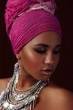 Ethnic beauty. Negro girl. Metallic silver necklace stock photos