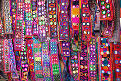 Ethnic belts with mirrors. Colorful ethnic belts with mirrors at Anjuna flea market in Goa, India royalty free stock image