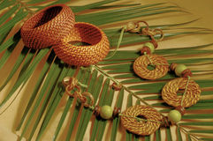 Ethnic bijouterie on palm leaf Stock Image