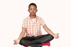 Ethnic boy yoga meditation Stock Images