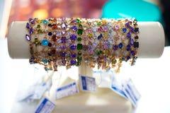 Ethnic bracelet hand plastic multi-colored stones Royalty Free Stock Photos