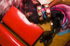 Ethnic bracelets of leather and metals with purce and sunglasses. Many ethnic bracelets of leather and metals Stock Photography