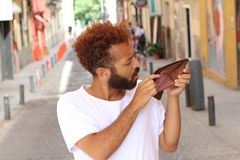 Ethnic broke guy with empty wallet outdoors Royalty Free Stock Photos