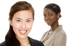 Ethnic Business. A chinese businesswoman standing in front of her colleague Royalty Free Stock Photo