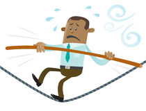 Ethnic Business Buddy walks the tightrope Royalty Free Stock Image
