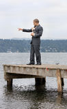 Ethnic Business Man Pointing with Dog Royalty Free Stock Images
