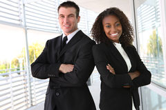 Ethnic Business Team. A diverse african and caucasian man and woman business team stock photo
