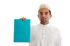 Ethnic businessman with brochure or advertisement. An ethnic mixed race businessman wearing cultural attire is holding a blank document, brochure, advertisement Stock Photo