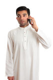 Ethnic businessman on cellphone Royalty Free Stock Images