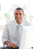 Ethnic businessman at a computer Stock Photography