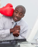 Ethnic businessman hit by a boxing glove Stock Image