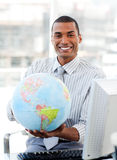 Ethnic businessman holding a terrestrial globe Stock Photos
