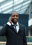 Ethnic businessman on phone Royalty Free Stock Photo