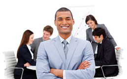 Ethnic businessman sitting in front of his team Royalty Free Stock Photos