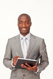 Ethnic businessman writing Stock Photo
