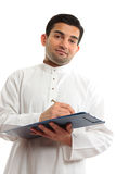 Ethnic businessman writing Royalty Free Stock Photography