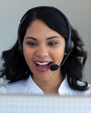 Ethnic businesswoman in a call center Royalty Free Stock Image