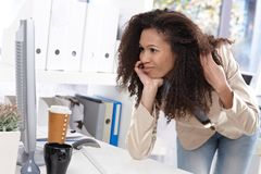 Ethnic businesswoman with computer smiling Royalty Free Stock Image