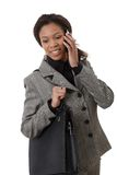 Ethnic businesswoman with mobile and bag Stock Photography