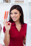 Ethnic businesswoman showing OK sign Stock Images