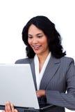 Ethnic businesswoman surfing the internet Stock Photo