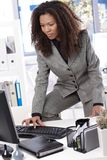 Ethnic businesswoman typing on keyboard Royalty Free Stock Photos