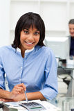 Ethnic businesswoman using a calculator Royalty Free Stock Photography