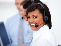 Ethnic businesswoman using earpiece Stock Image