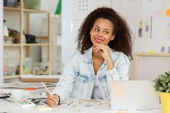 Ethnic businesswoman at work Stock Images