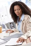 Ethnic businesswoman at work Stock Image