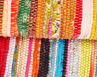 Multicolored ethnic carpets closeup Stock Photos