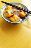Ethnic chinese dish, stuffed beancurd skin. A photograph showing a traditional ethnic chinese food of fried beancurds skin, with a hole slit in the side to form Stock Photography
