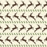 Ethnic Christmas seamless pattern with deer Stock Photos