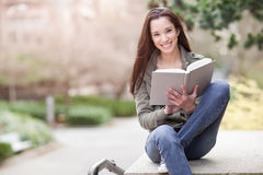 Ethnic college student studying stock image