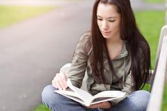 Ethnic college student studying stock photo