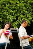 Ethnic college students read books Stock Photo