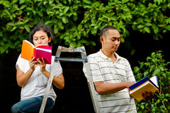 Ethnic college students read books Royalty Free Stock Photo