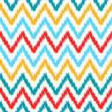 Ethnic colorful ikat abstract geometric chevron pattern in white, blue, red and yellow,  Stock Photos