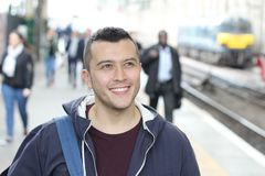 Ethnic commuter smiling in the crowd royalty free stock image