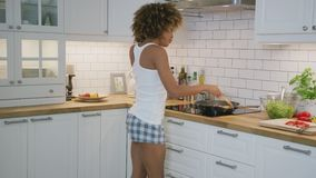 Happy woman dancing in kitchen stock footage