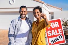 Free Ethnic Couple Holding New House Keys Stock Image - 195195141