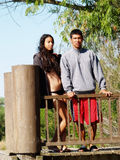 Ethnic Couple Standig At Rail On Dock Royalty Free Stock Photography