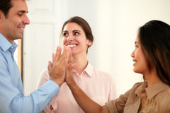 Ethnic coworkers team huddle their hands Stock Image
