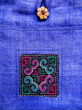 Ethnic cross stitch pattern on bag. A beautiful and rustic style cross stitch pattern on a handicraft bag of southeast asian origin. Done on coarse woven fabric stock photos