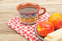 Ethnic cup of coffee. And Wafer biscuit on the beautiful old wooden background royalty free stock photos